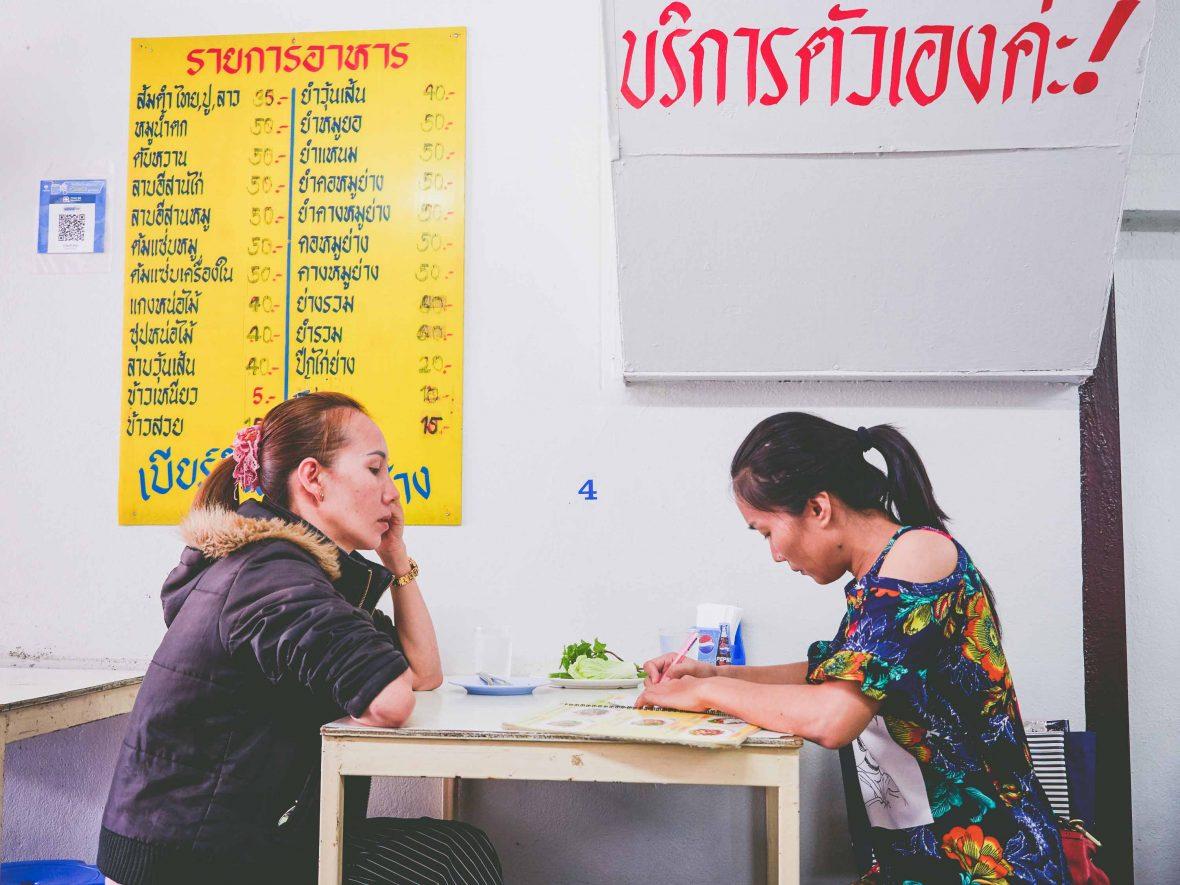 Chiang Mai street food: Chiang Mai street food: Customers at Malli Chaiya's papaya salad stall 'Toy Roszab' on Chiang Mai's Kampangdin Road.