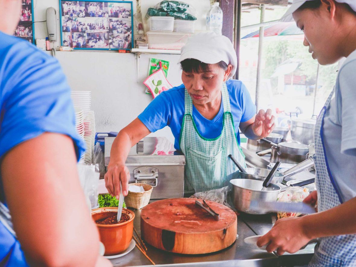 Chiang Mai street food: Malli Chaiya serves customers at her papaya salad stall 'Toy Roszab' on Chiang Mai's Kampangdin Road.