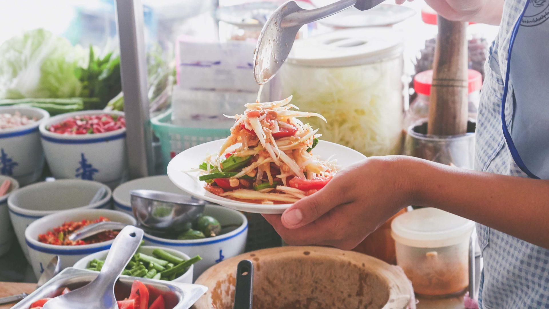 Chiang Mai street food: 51-year-old Malli Chaiya serves up papaya salad at her papaya salad stall 'Toy Roszab' on Chiang Mai's Kampangdin Road, Chiang Mai.