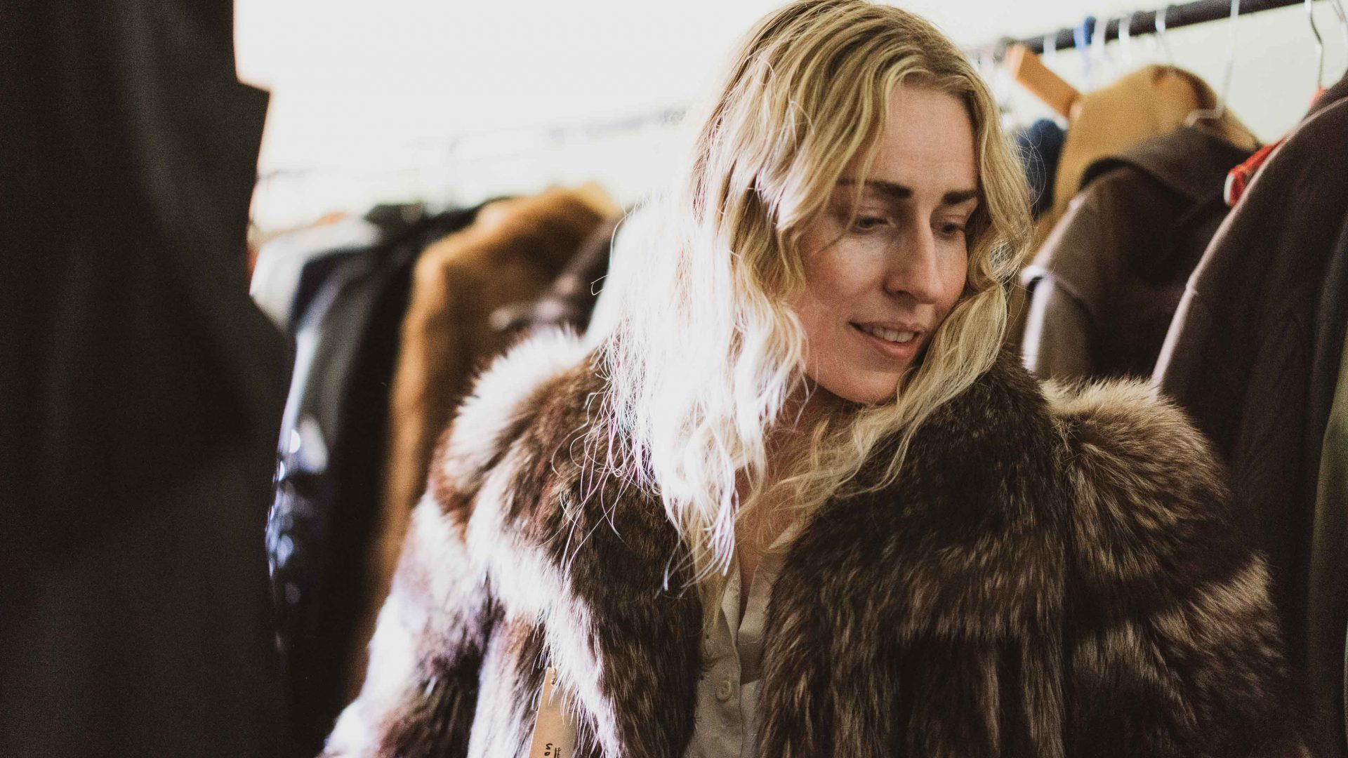 Chef Christie Peters tries on a fur coat in Saskatoon, Canada.