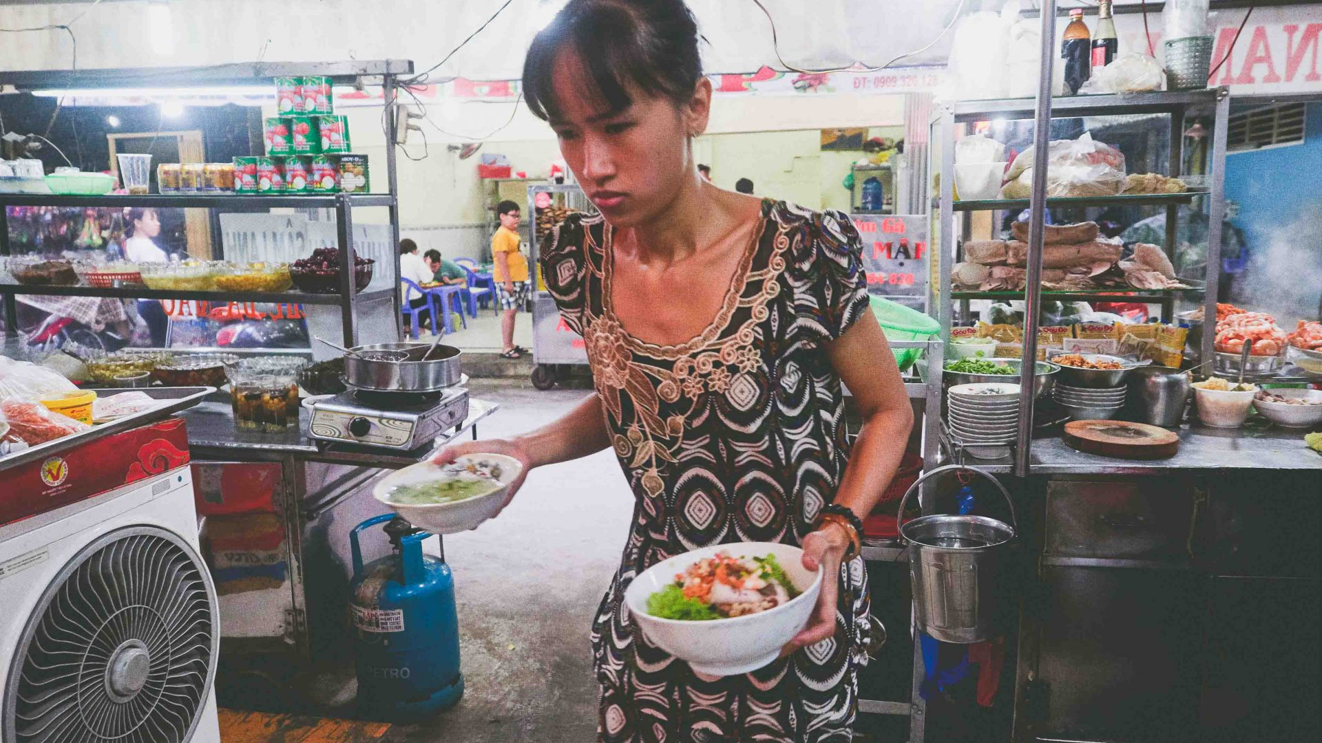 Ho Chi Minh street food: Food is taken out to tables at Vo Thi Ngoc Nhung's food cart, Amen.