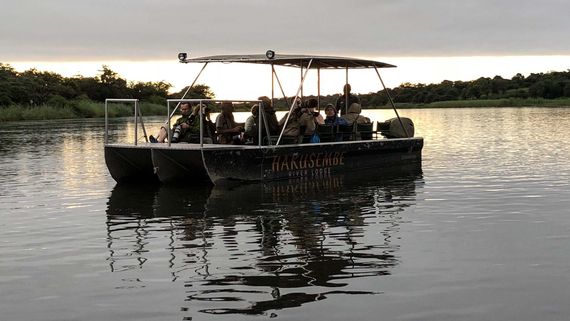 A craft from Hakusembe River Lodge navigates the waterways.