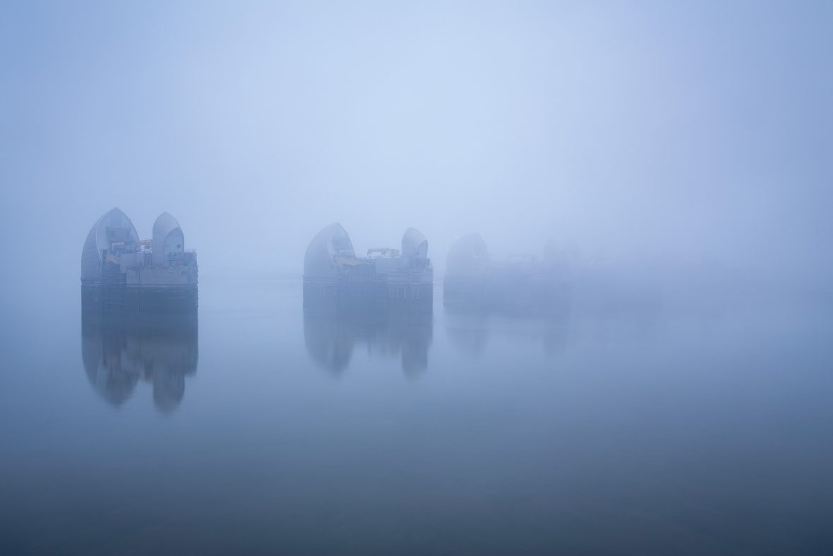 Mist obscures the Thames Barrier in London.