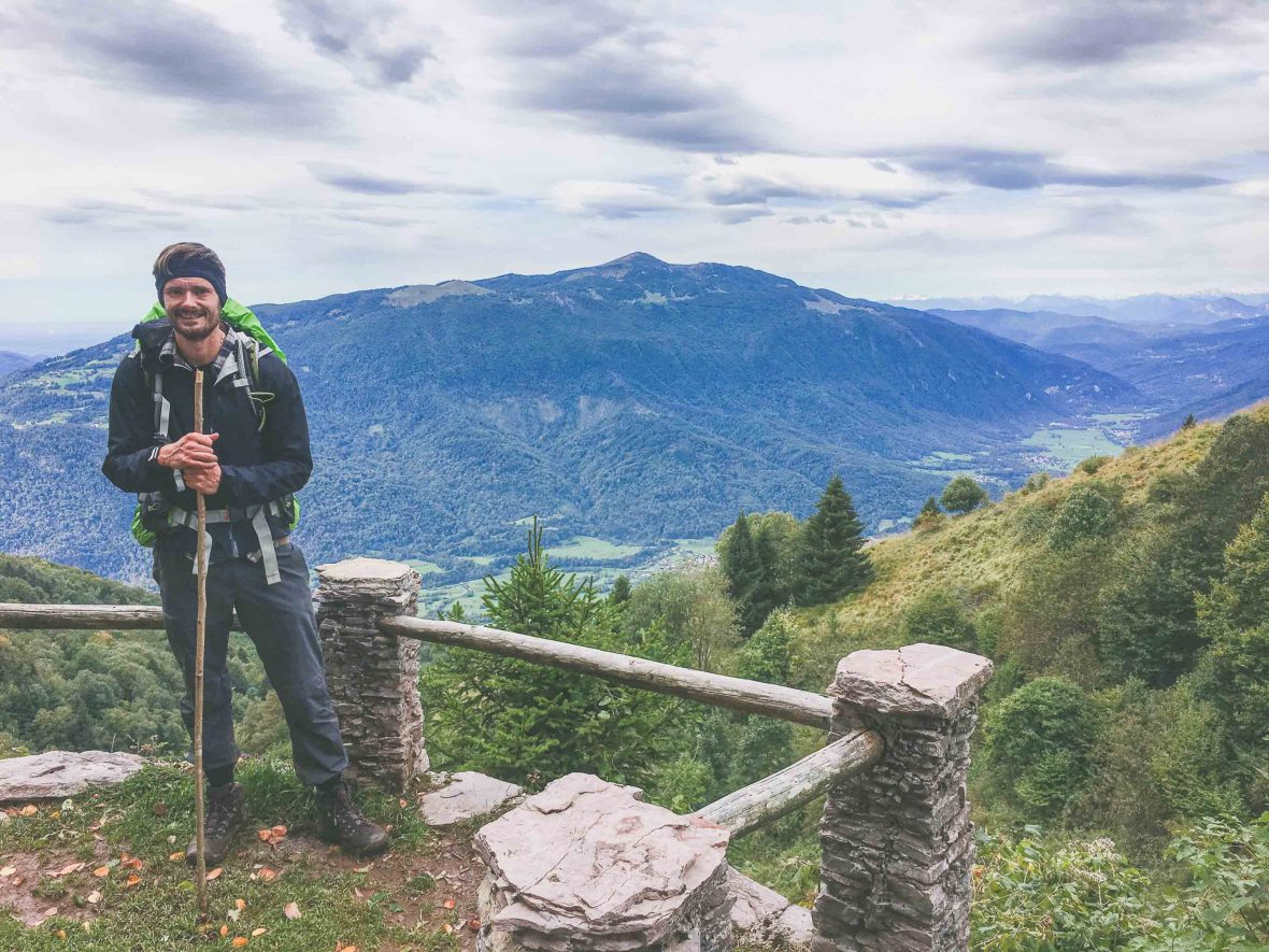 Featured contributor Leon McCarron on a lookout point on the Alpe Adria hiking trail in Slovenia.