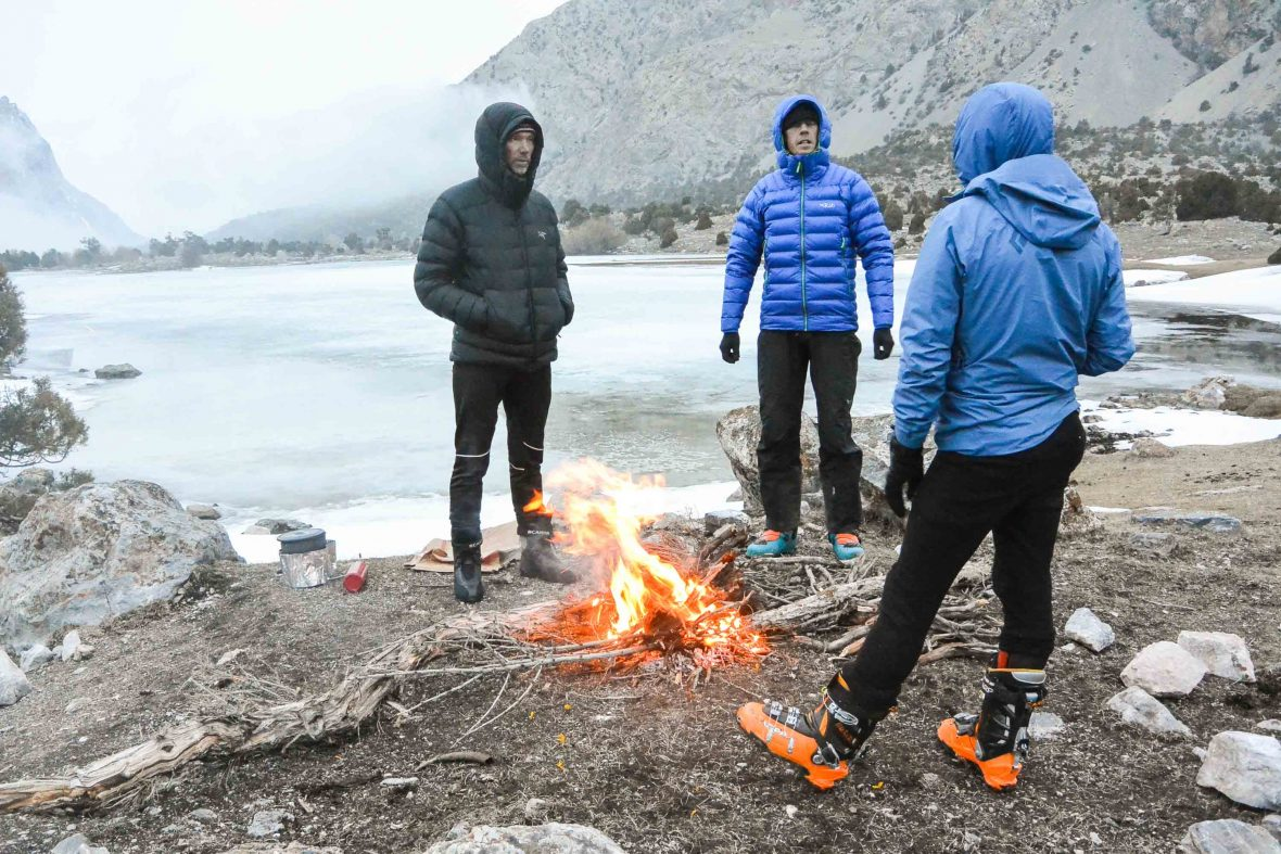 A warming fire near the snowline at Hulisbek Lake, Tajikistan.