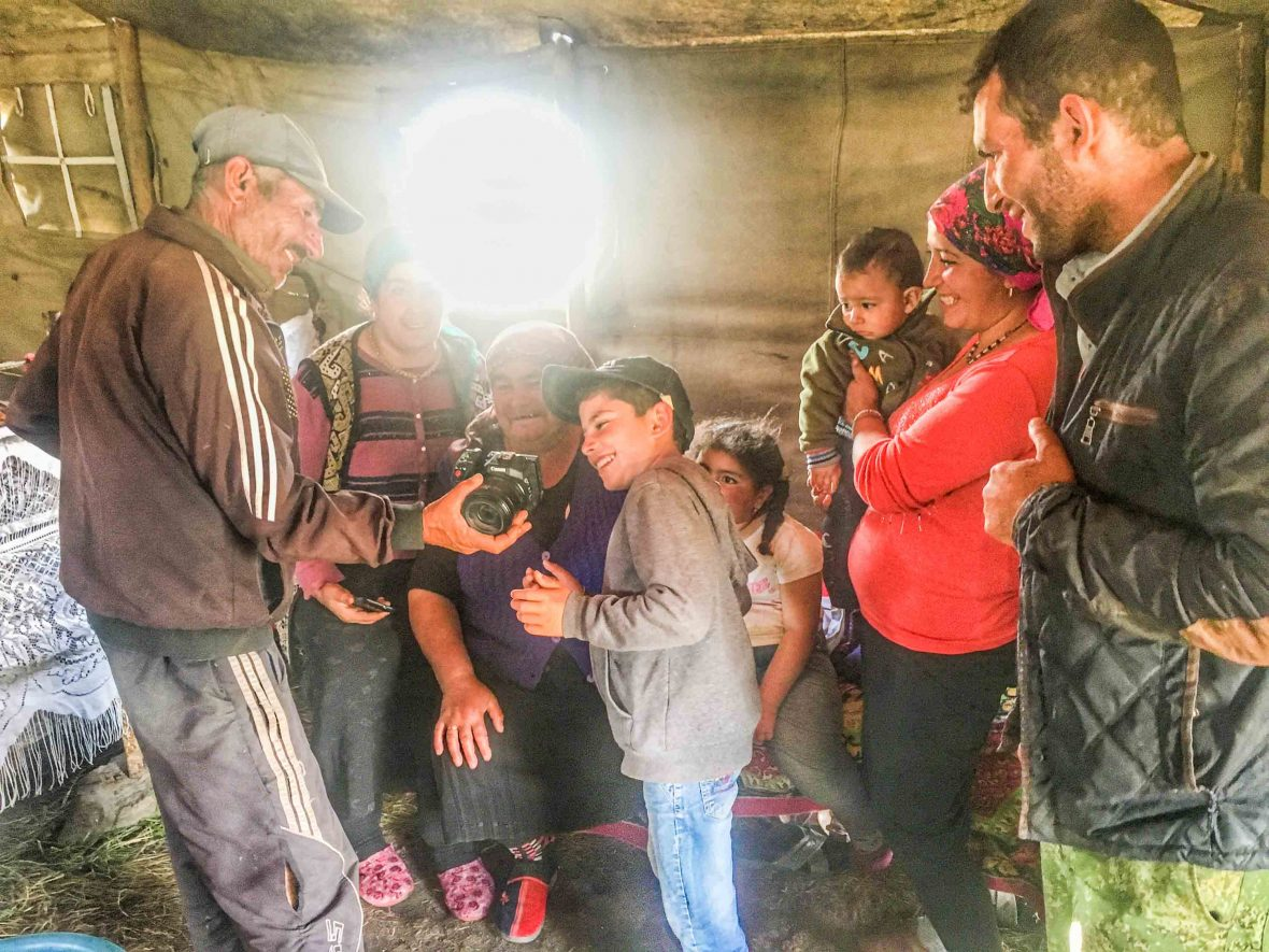Yezidi nomads enjoy looking at photos taken by the hikers during their trip through the Caucasus, Armenia.