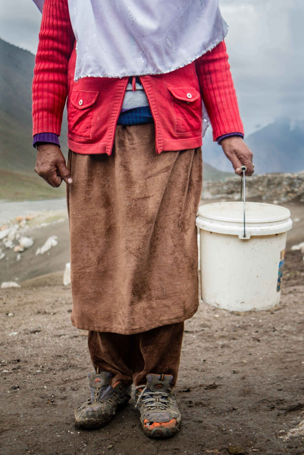 A shepherdess prepares to go milking.