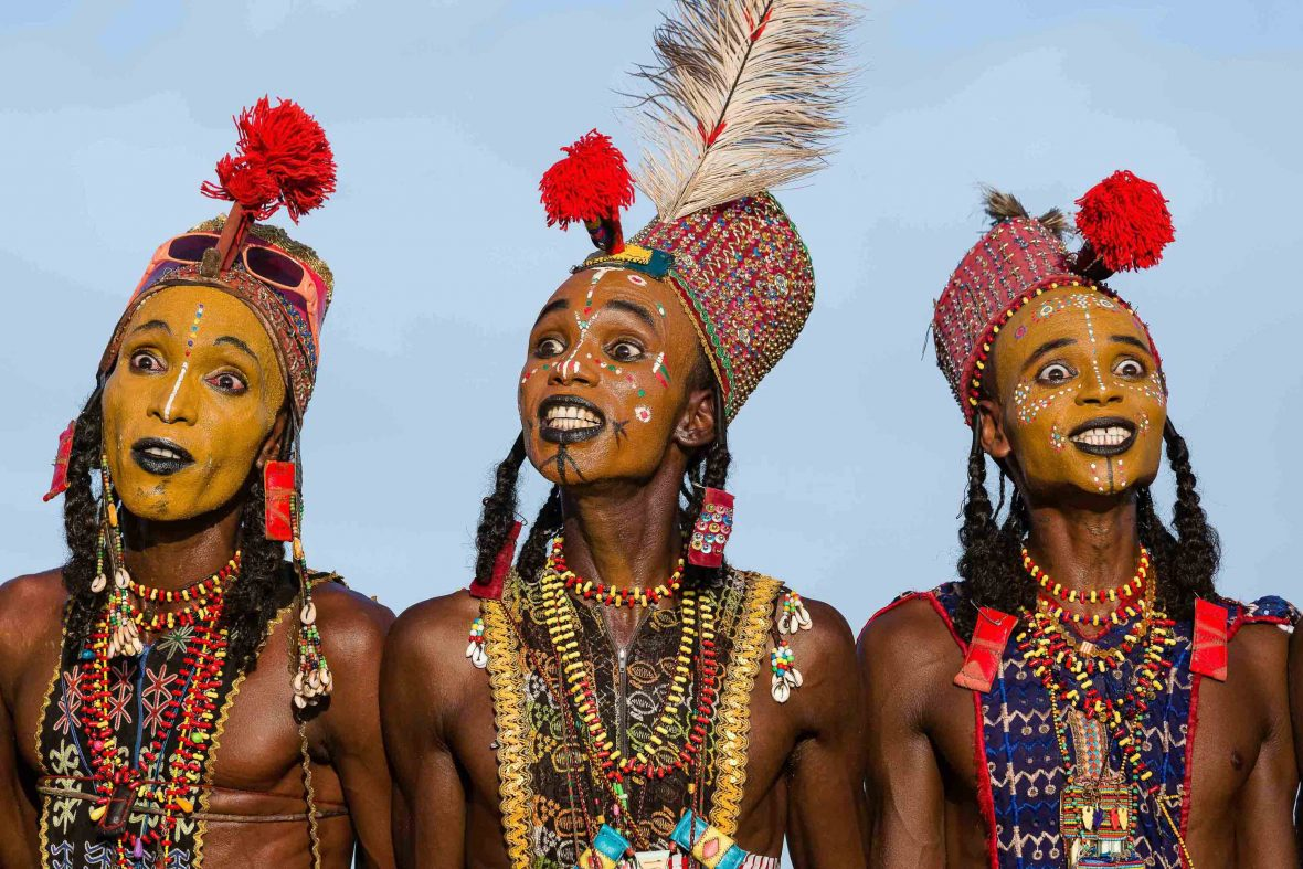 Three Wodaabe men perform their ritual dance the 'Yaake', where every element and gesture has a significance.