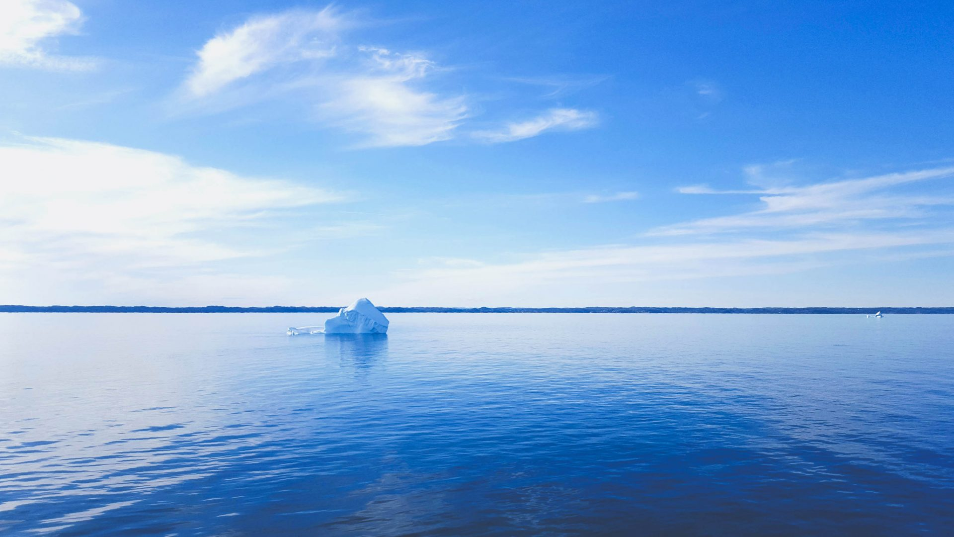 A lone iceberg in the water on the St. Lawrence River in Quebec.