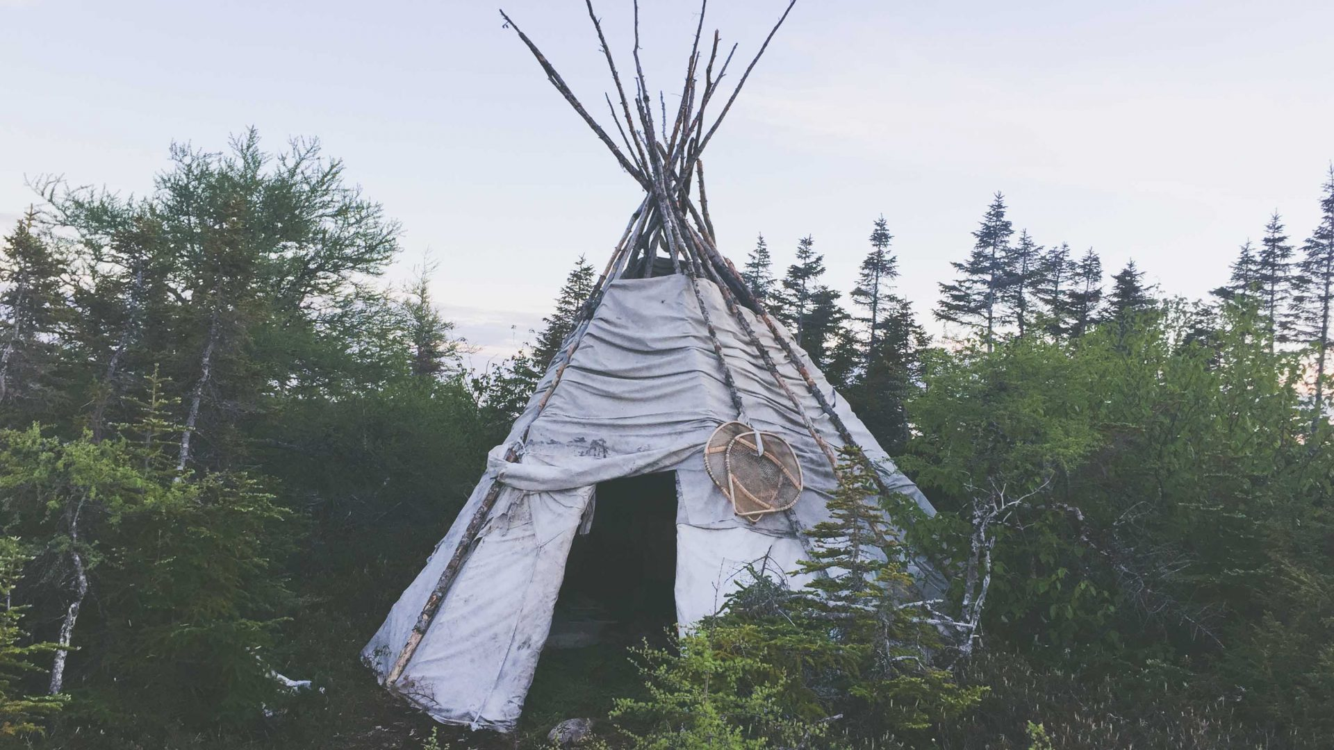 In Saint-Augustin, an Innu man has set up his tipi with his family in view of the cargo ship with a view to help share his culture with visitors.