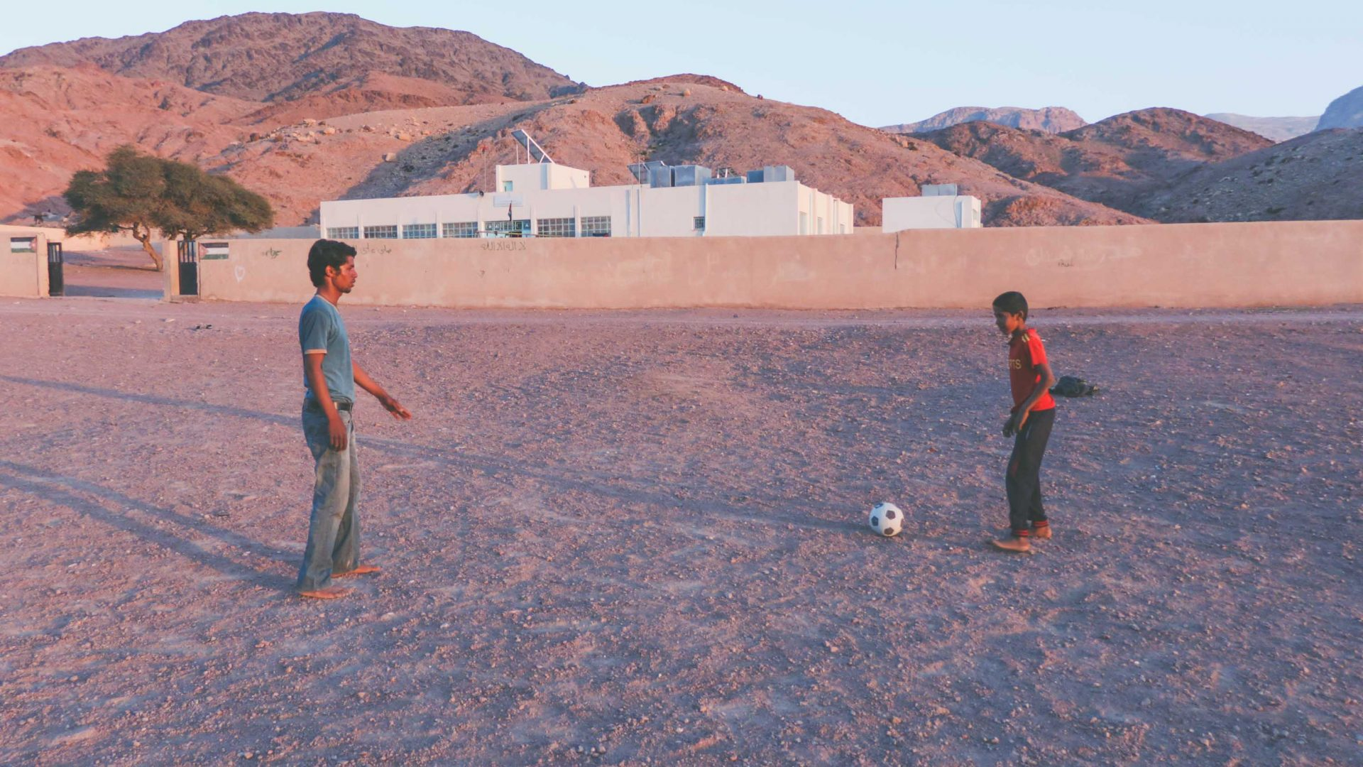 Local kids playing football in Wadi Feynan in southern Jordan.