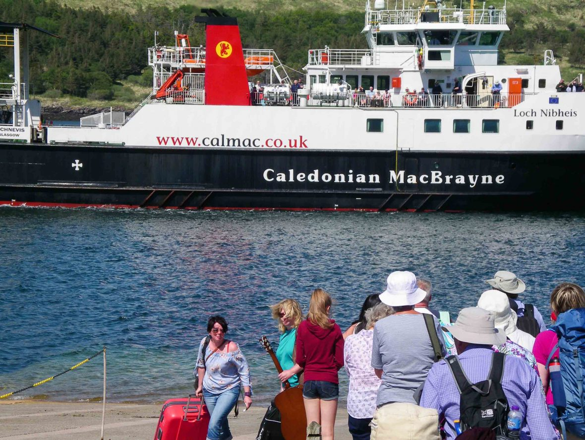 Passengers waiting to board the Calmac ferry at Rum, Scotland.