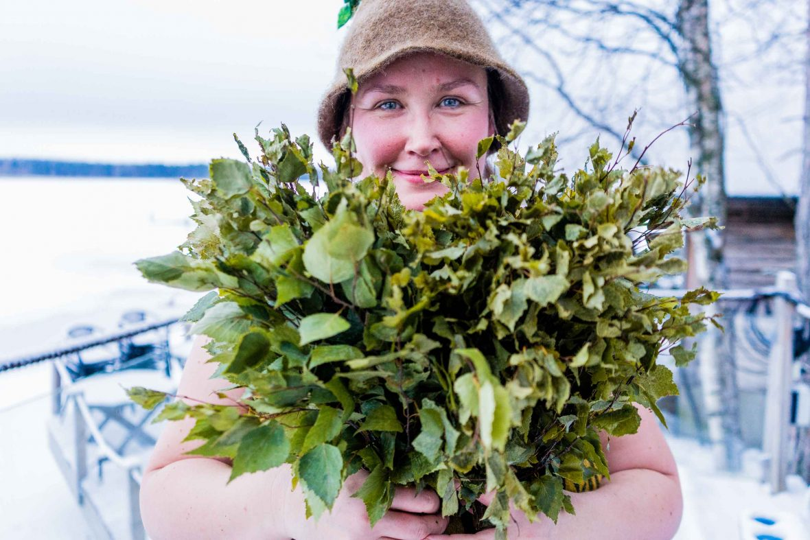 Traditional folk healer and Finnish sauna specialistMaaria Alén poses with the juniper branches she uses to whip guests at Lehmonkärki eco-lodge.