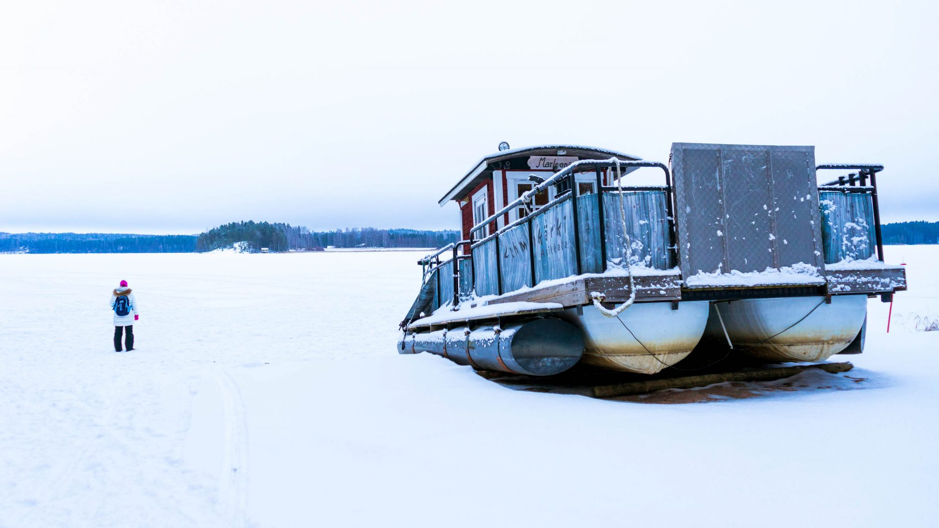 A sauna in Finland sits marooned on the snow.