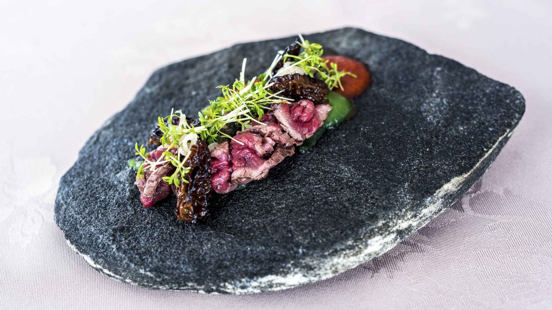 Dried aged reindeer (18-20 days) with a puree of watercress, kimchi, shallots and fried morels.