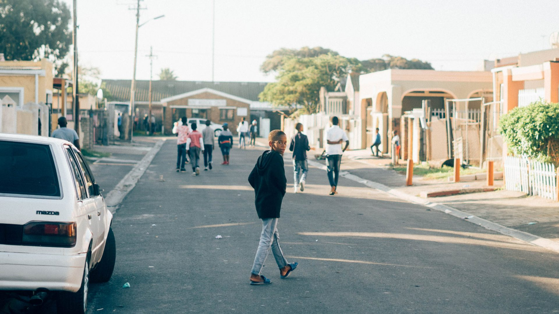 Kids make their way down one of the streets of Langa, Cape Town.