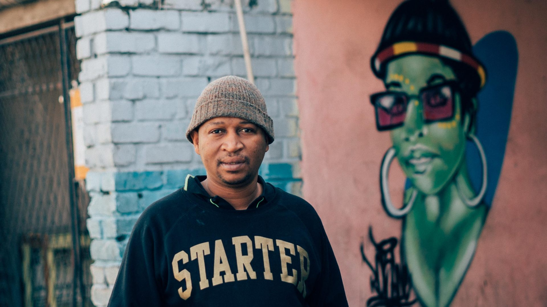 Robane and one of his favorite portrait pieces in Langa, Cape Town.
