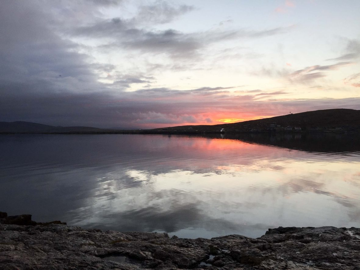 Sunset over the water in Hebrides, Scotland.