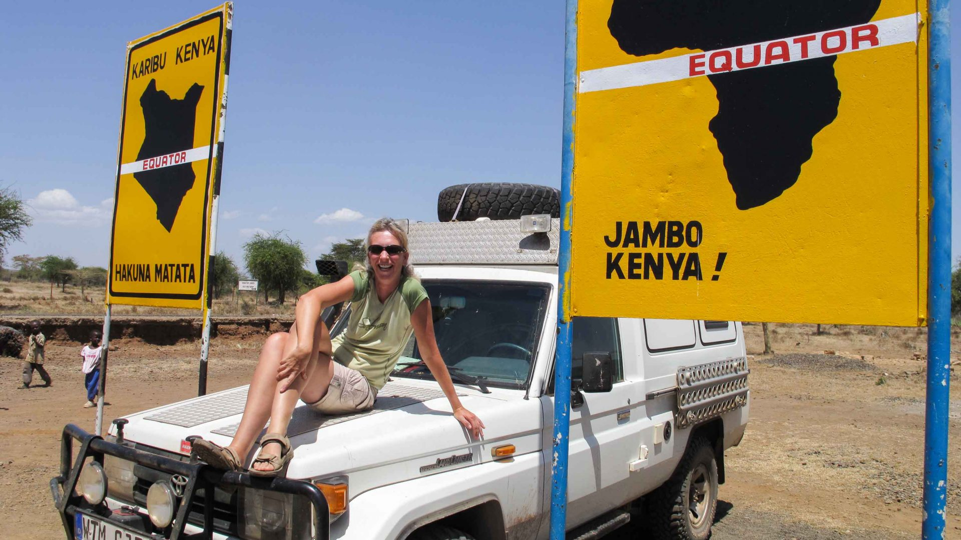 Claudia Janssen at the equator in Kenya.