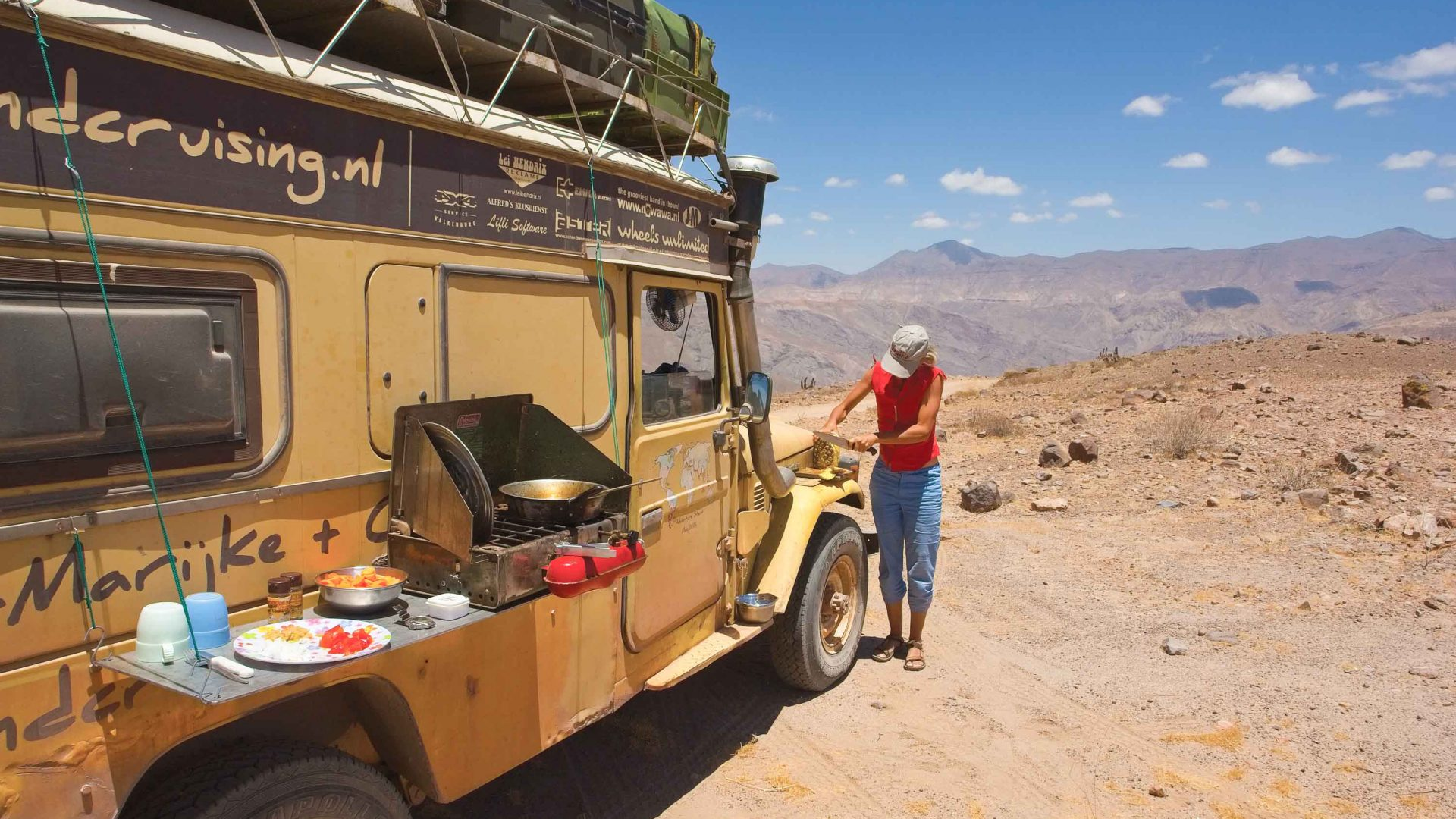 Karin Marijk prepares dinner in their Land Cruiser in Brazil.