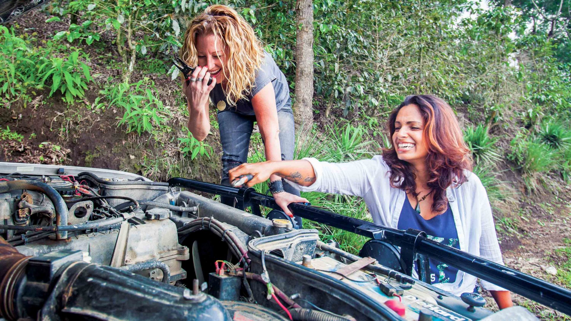 Sunny and Karin fix their truck in Guatemala.