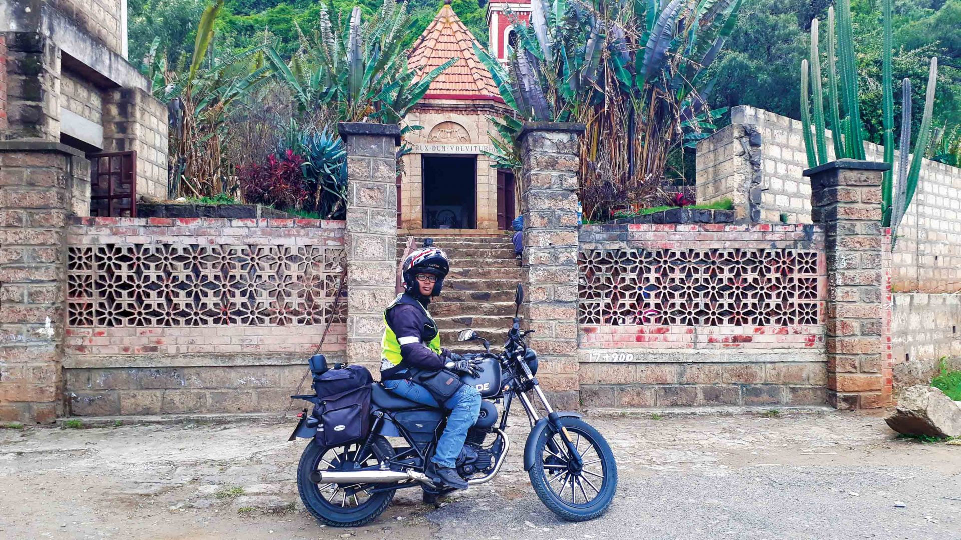 Wamuyu on her bike outside the smallest church in Kenya.