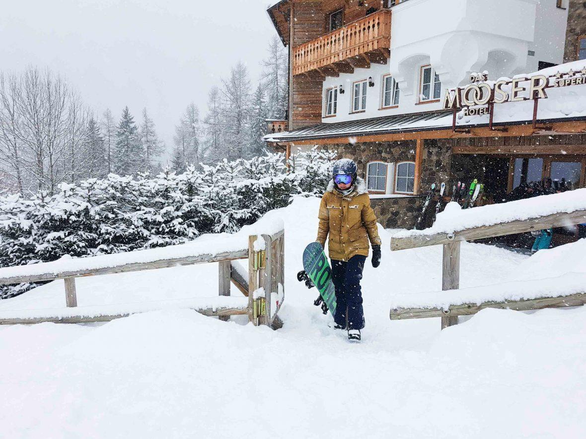 Writer Jennifer Ennion carries her snowboard at the resort town of St. Anton am Arlberg, Austria.