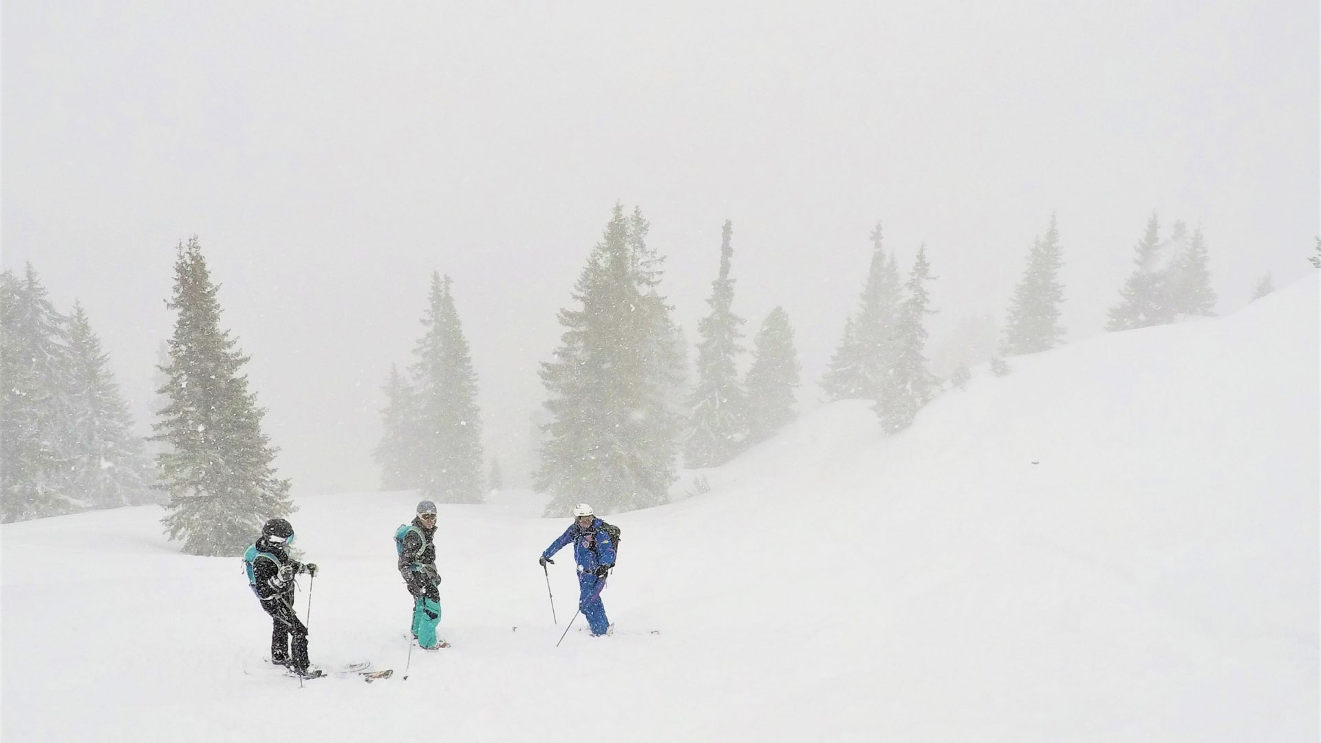 Skiers pause in a blizzard at St. Anton am Arlberg, Austria.