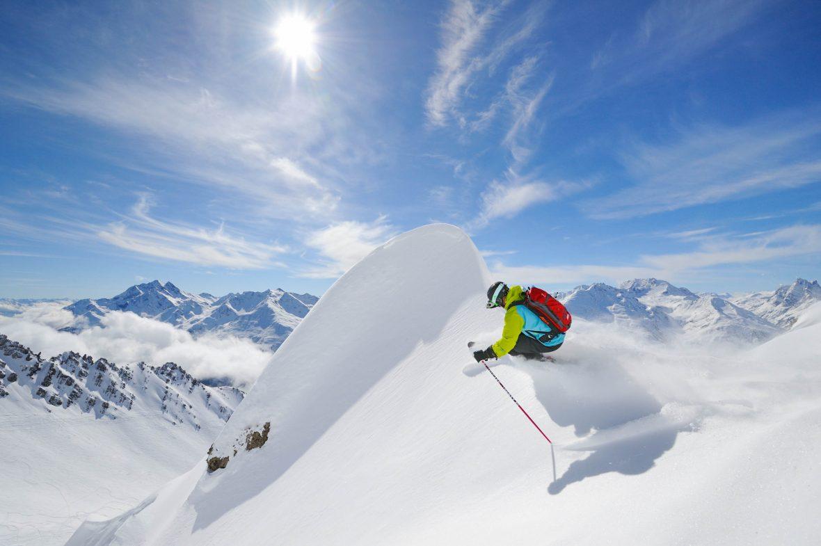 A skier carves in fresh powder in St. Anton am Arlberg, Autria.