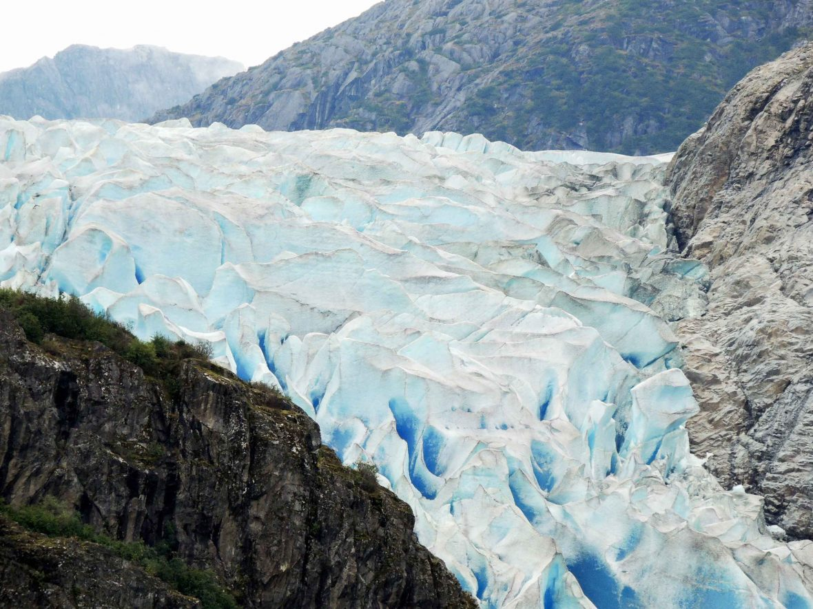 The Herbert glacier in Juneau, Alaska, makes its way through a mountain crevice.