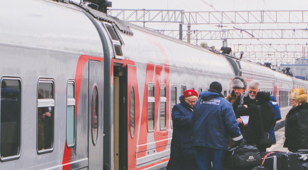 Passengers alight the train on the Transiberian Railway.
