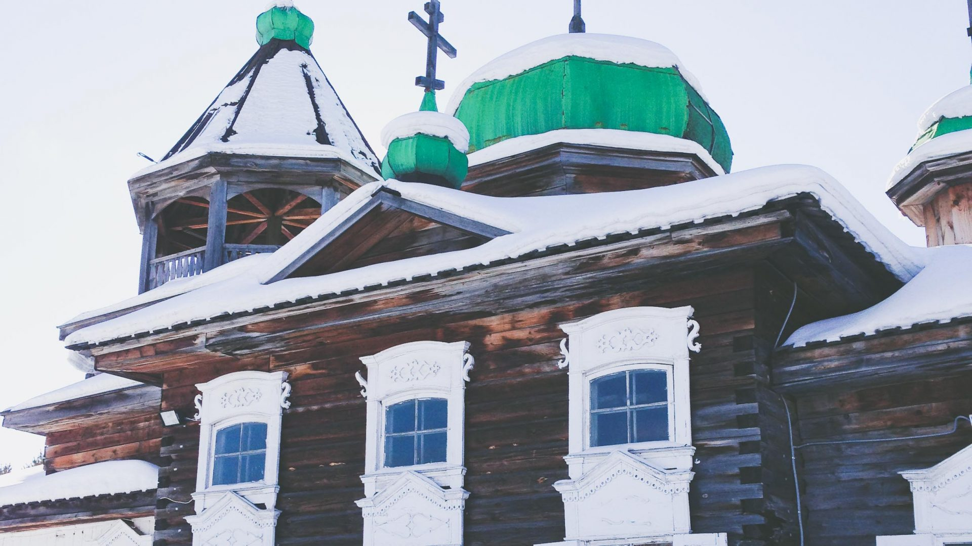 A church covered in snow along the route of the Trans-Siberian railway journey.