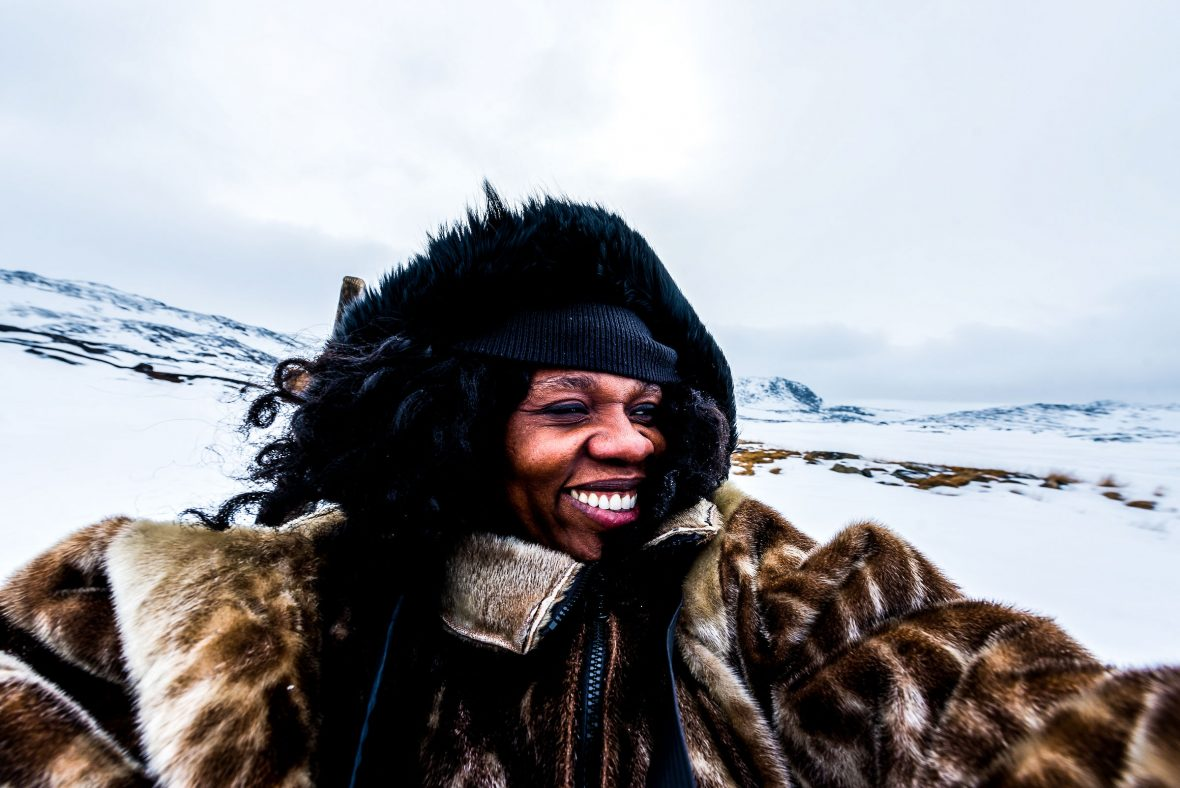 Travel writer Lola Akinmade Åkerström takes a rare selfie while dog-sledding in Ilulissat, Greenland.