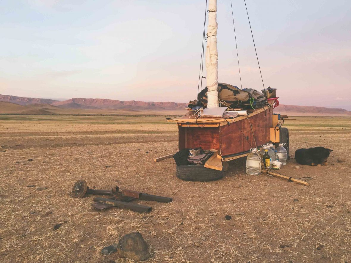 Falcon and Amber's land sailing cart set against the dry, vast backdrop of the Mongolian landscape.