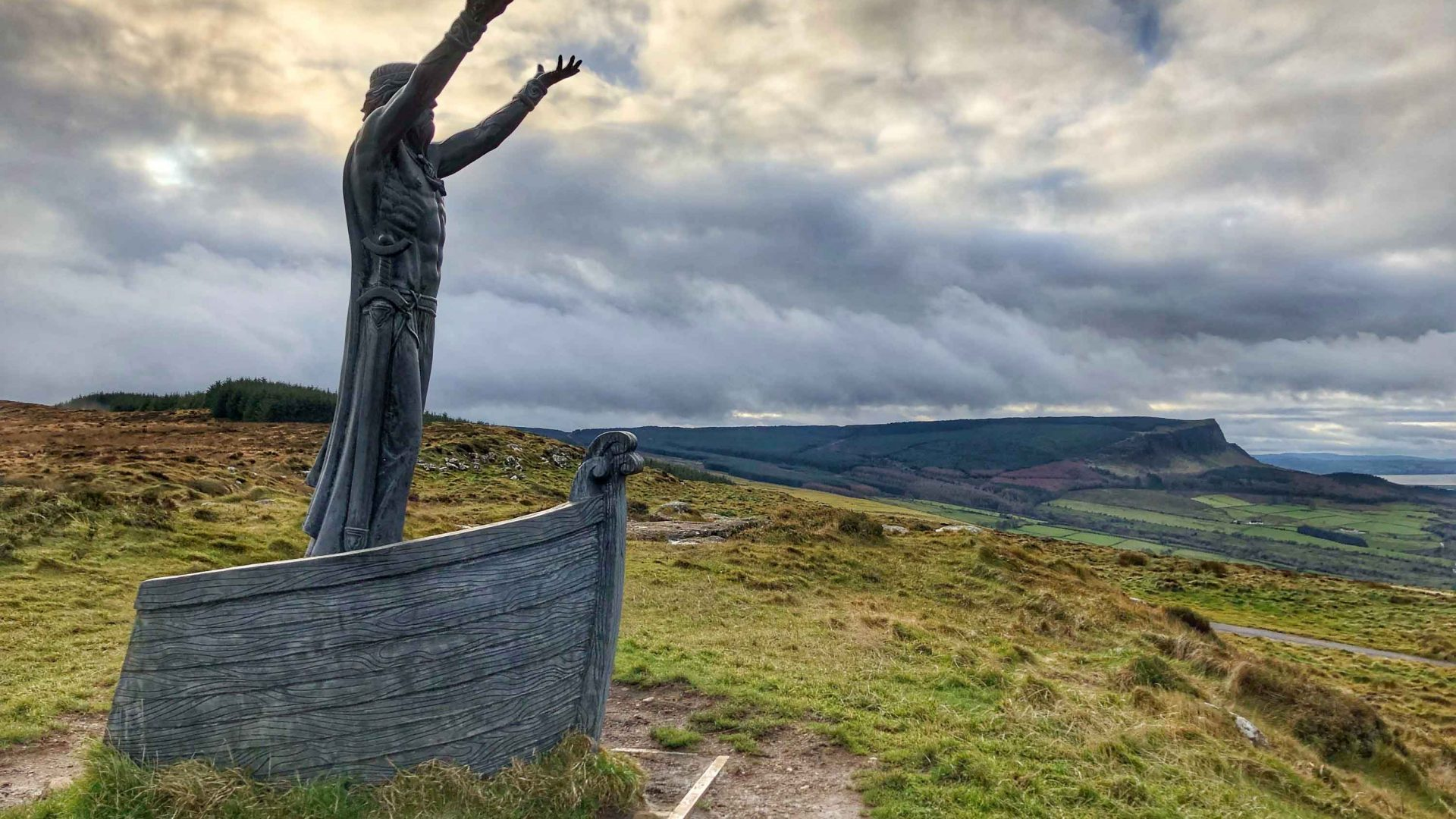 Manannán mac Lir at Gortmore viewpoint, looking out to Magilligan Point, Greencastle town and the Inishowen Peninsula.