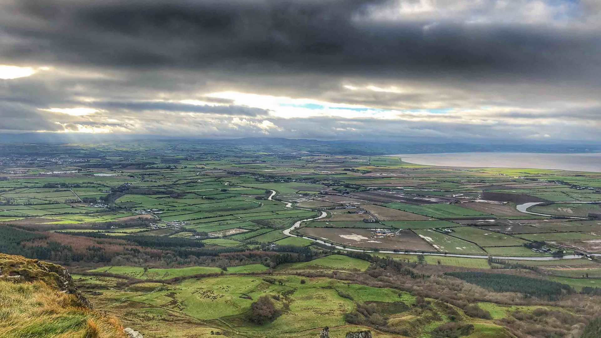 Views across to Magilligan and Limavady with Lough Foyle in the distance from the top of Binevenagh mountain.