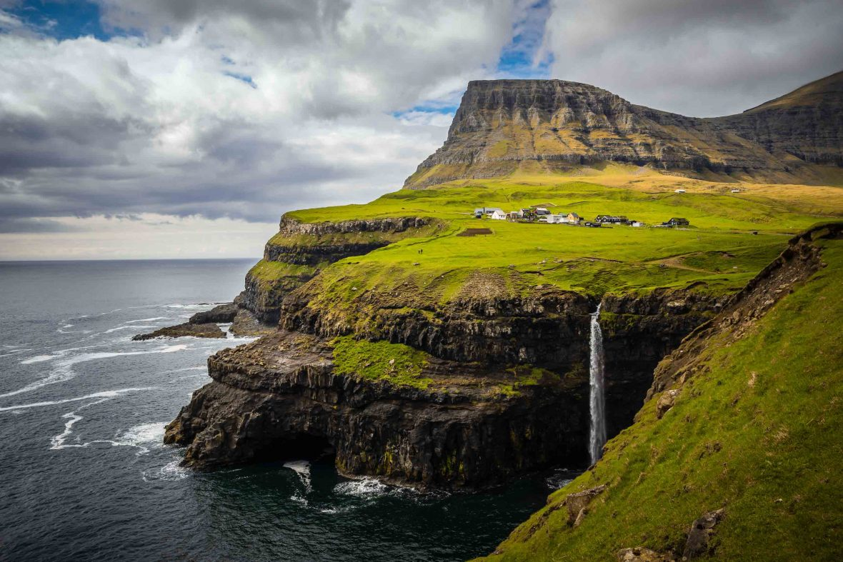 The village of Gásadalur and its iconic Múlafossur waterfall, on the Faroe Islands, which plunges into the raging North Atlantic.
