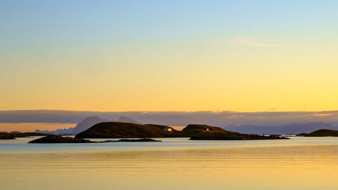 A golden sunrise on Fleinvaer archipelago, Norway.