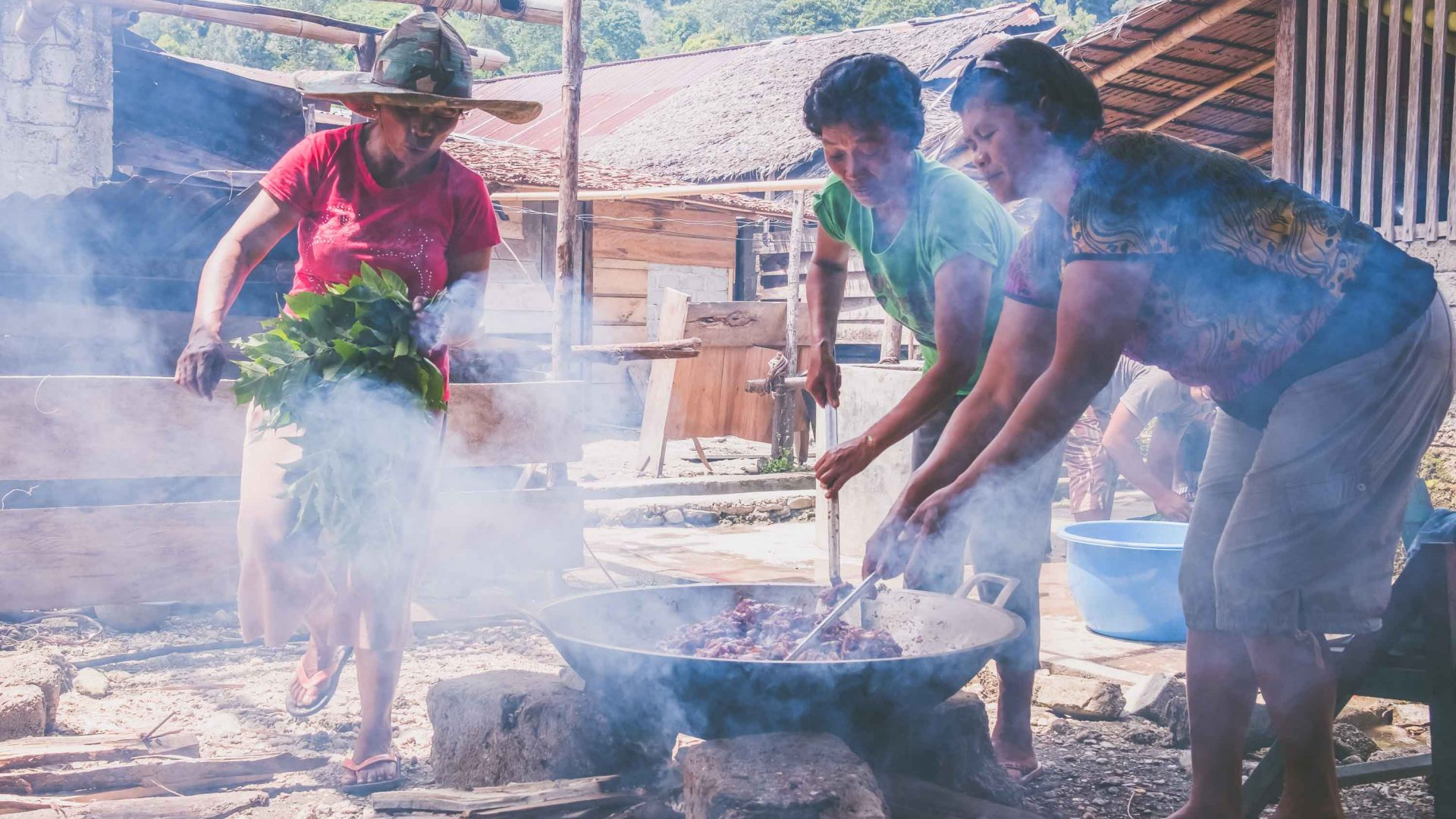 Women barbeque in the village of Bancea in Indonesia.