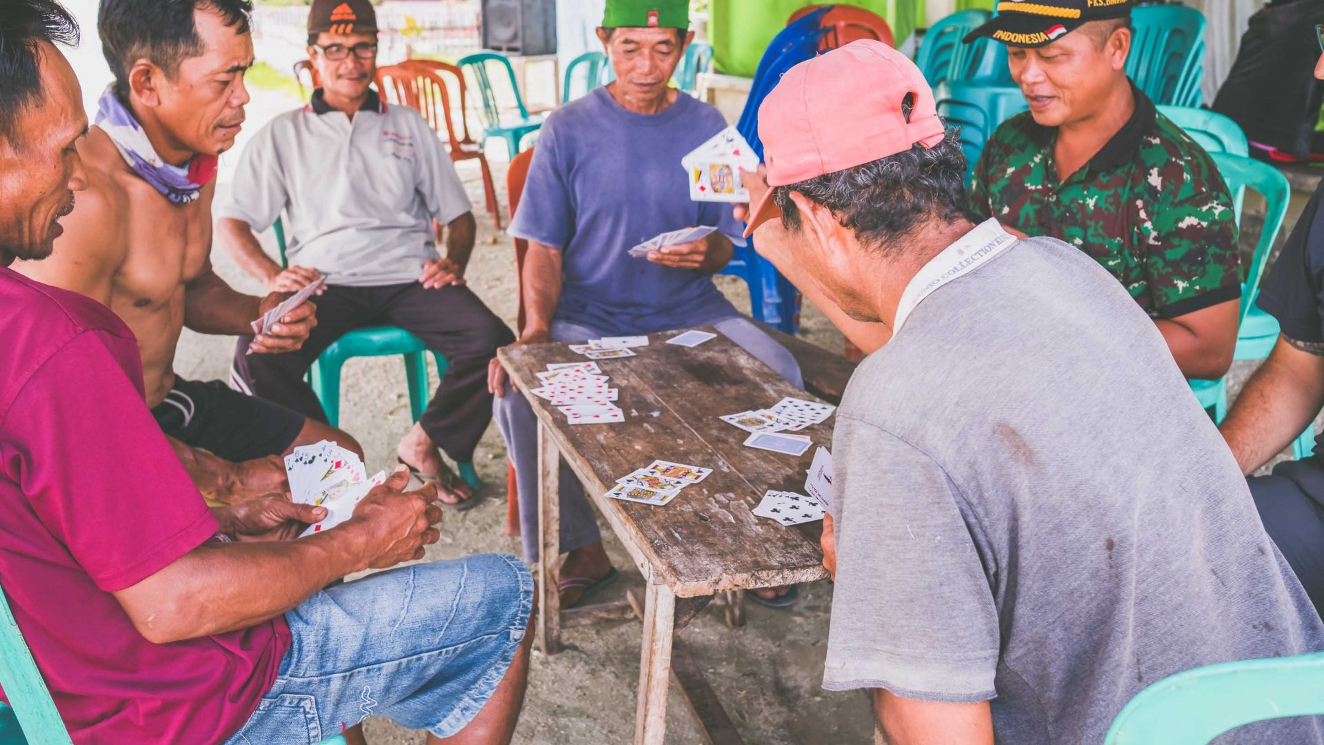 Men play cards in the village of Bancea in Indonesia.