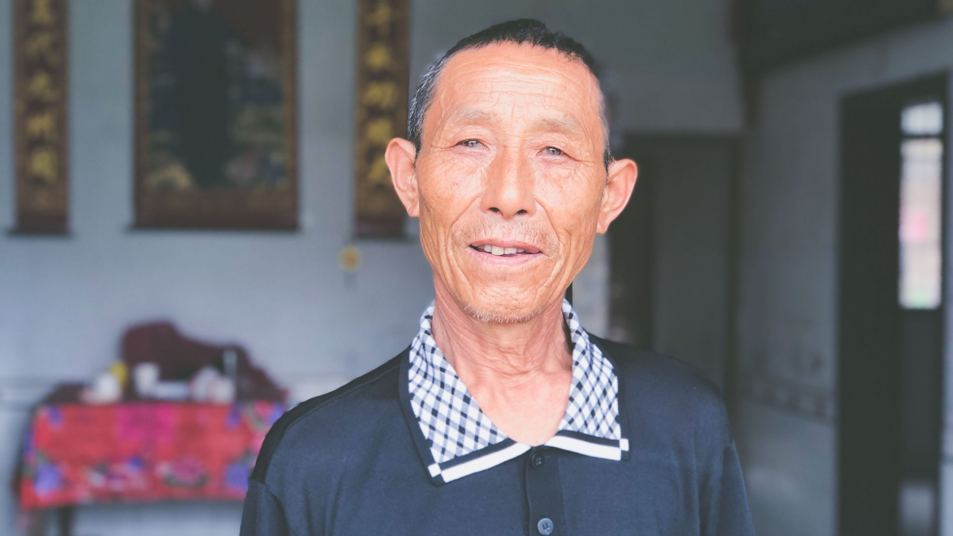 Zunzhu, a farmer, talks about the Tujia minority who live in the surrounding hills.