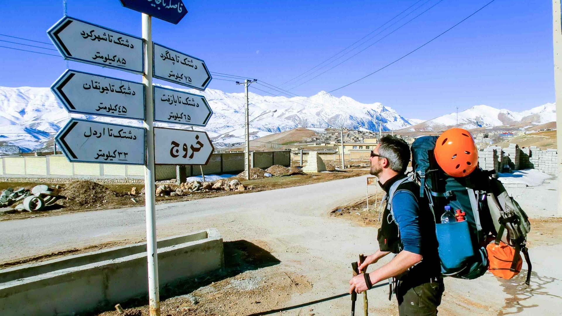 Tom follows the Farsi road signs.