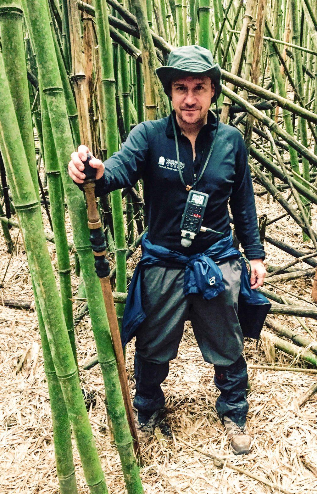 Jon Holmes searching out gorillas in Volcanoes National Park, Rwanda.