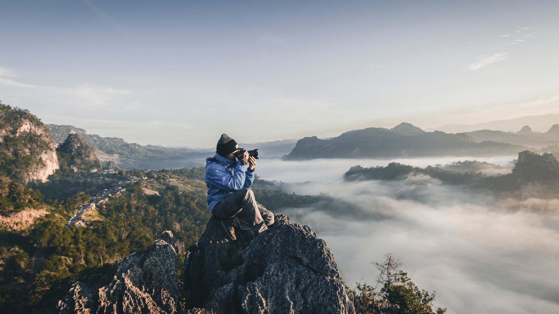 A man takes a photograph at Baan Ja Bo, Mae Hong Son, Thailand.