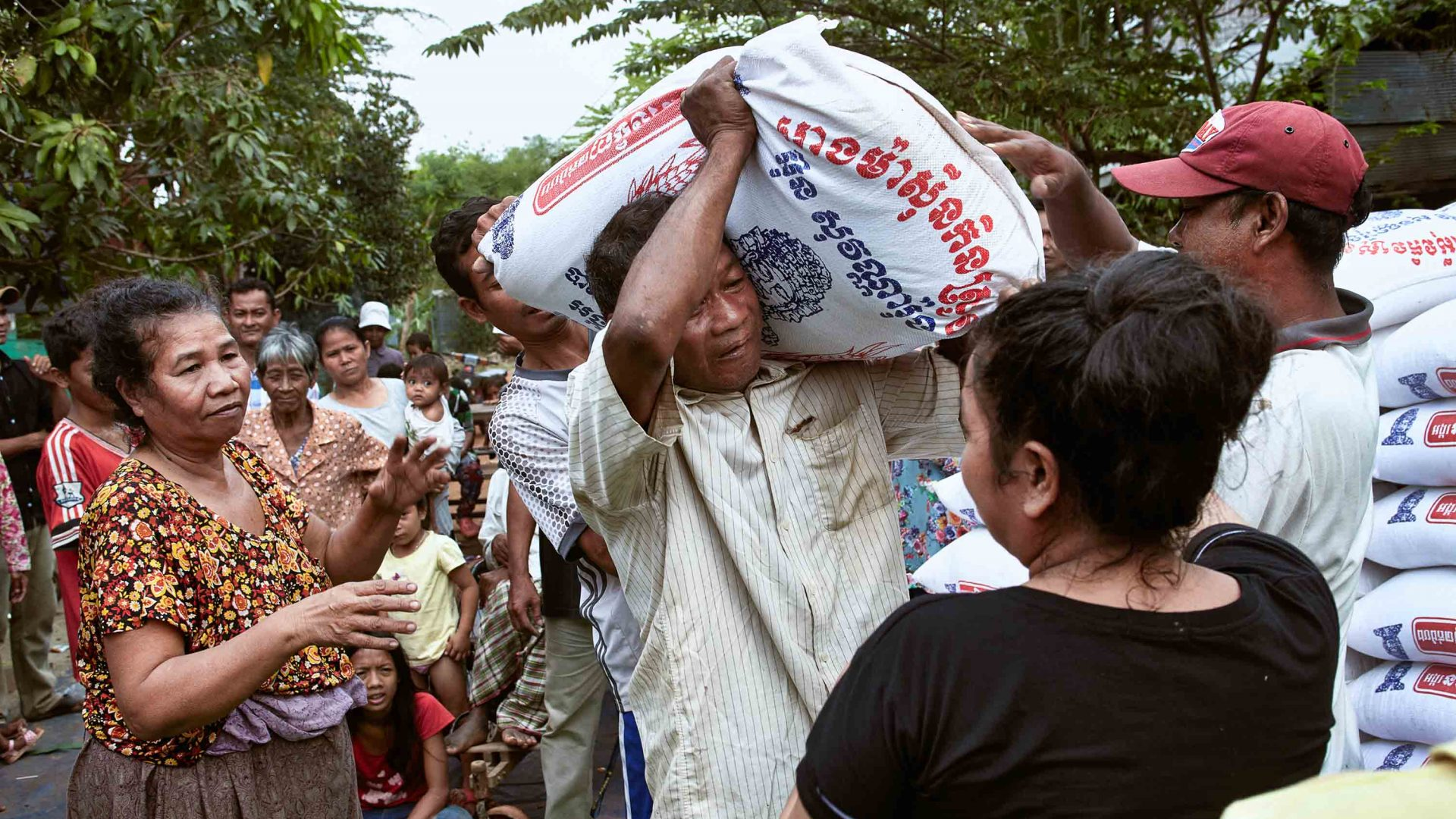 Carrying bags of rice in Cambodia.