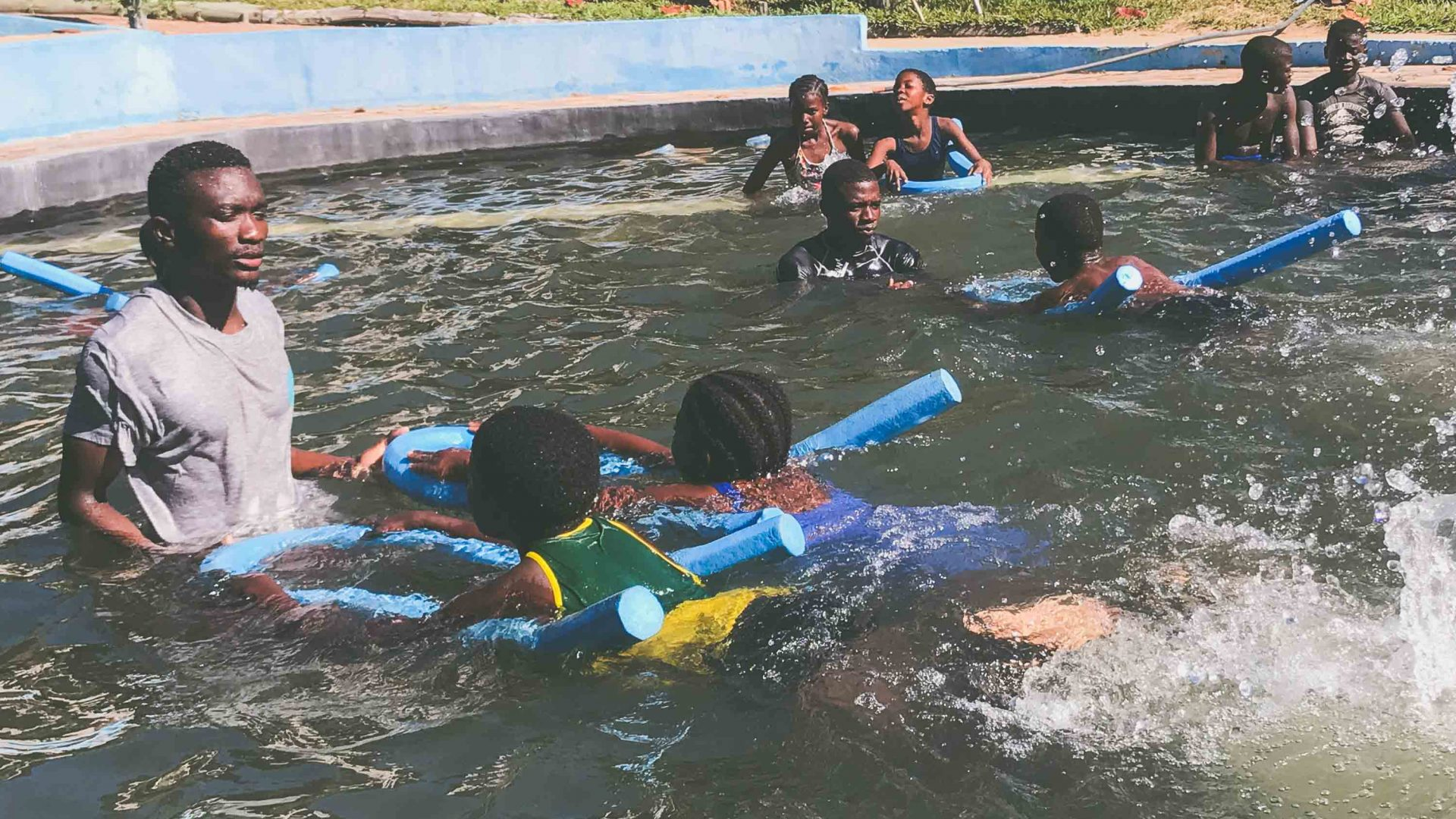 Pedro (left) and Simone (center) teach swimming in Tofo in southeastern Mozambique as part of the Ocean Guardians program.