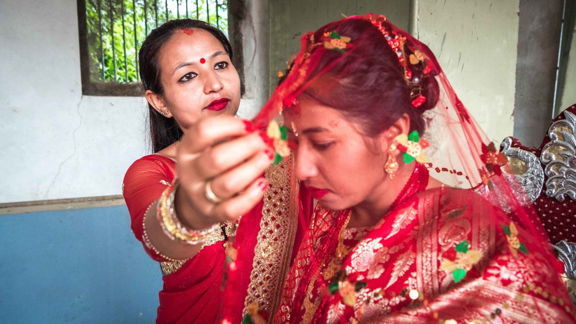 A bride gets ready at a wedding in Panauti, Nepal.