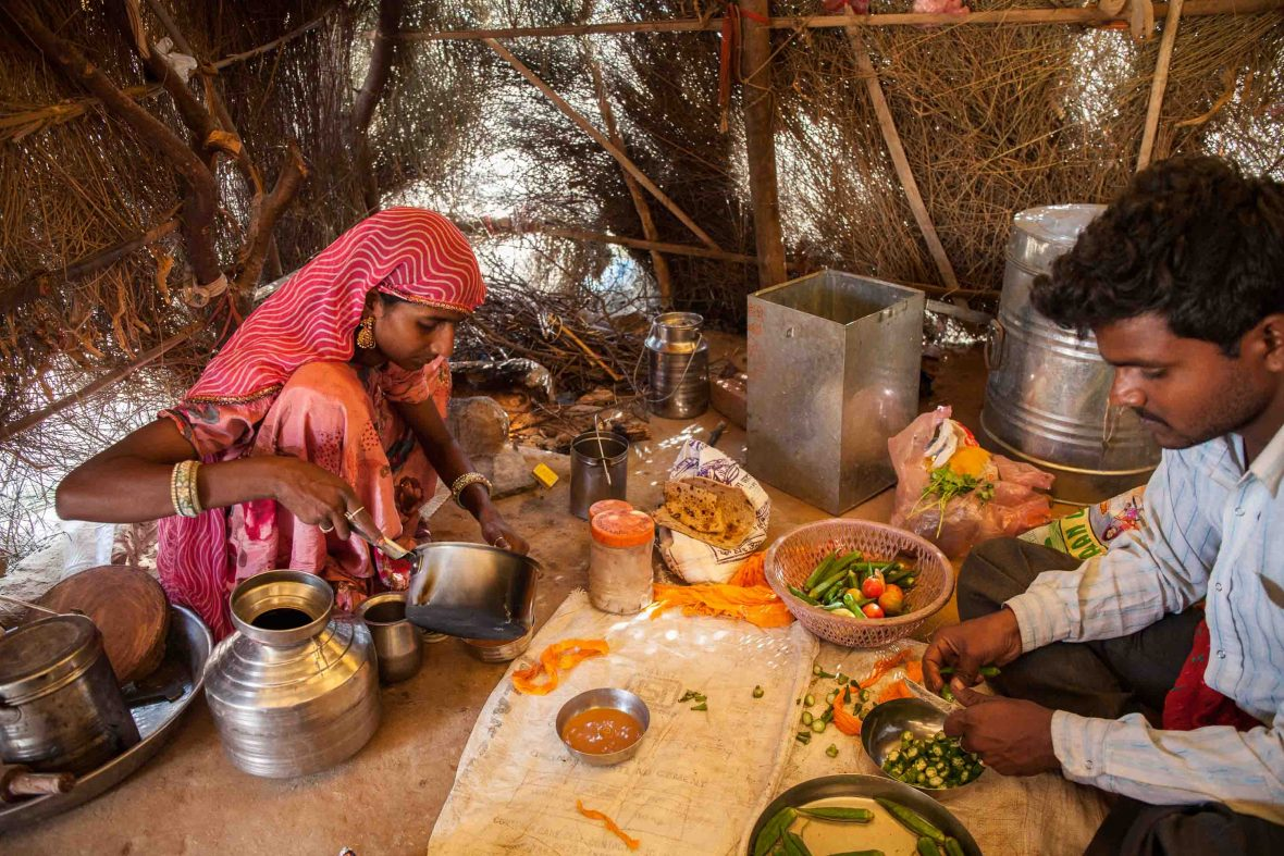 Ram and his wife prepare food in their home in a small village just outside of Pushkar.