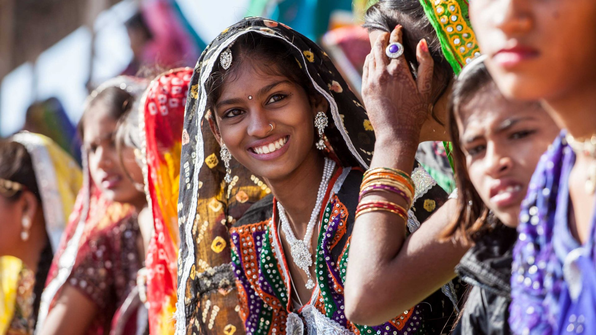 A girl at a beauty contest smiles during the cultural programme of Pushkar Camel Fair.