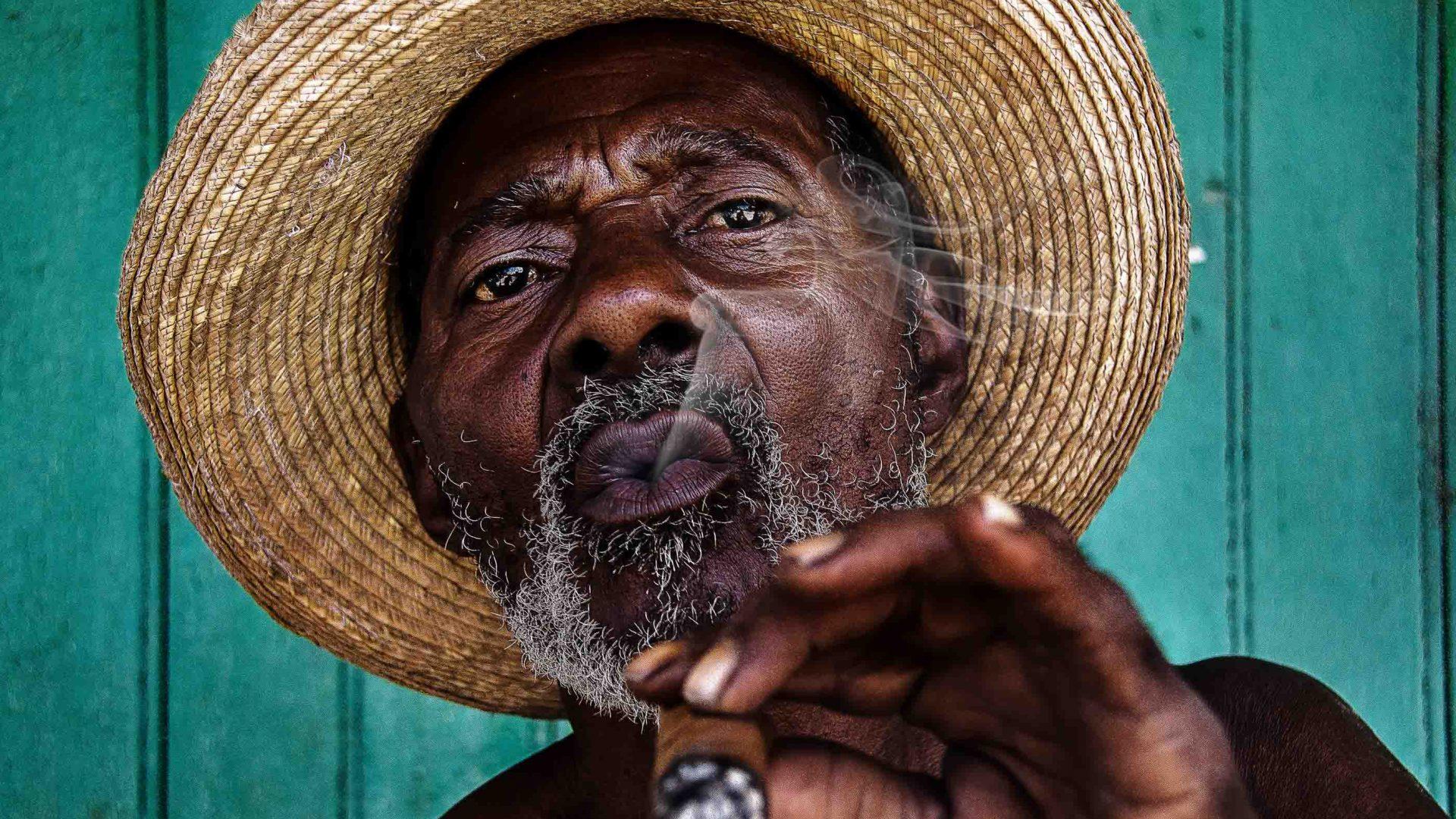 A man smokes a cigar in Cuba.